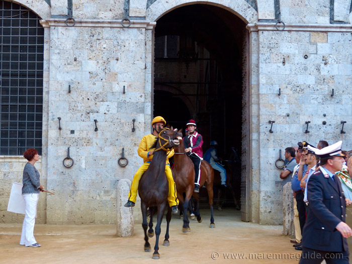 Palio di Siena horses leaving the Palazzo Pubblico at the start of the race.