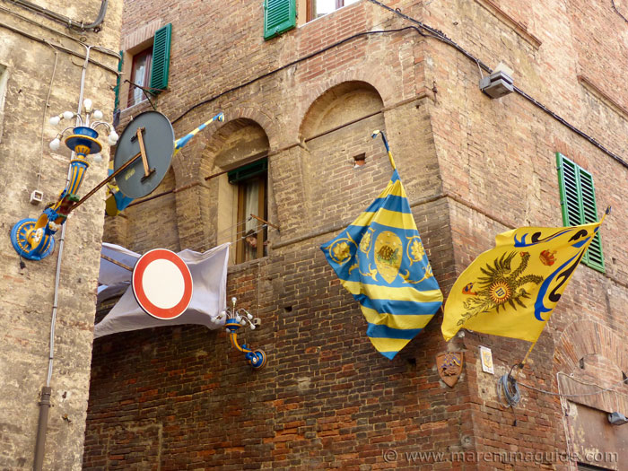 Street corner in Siena where the territory of two Contrade meet.