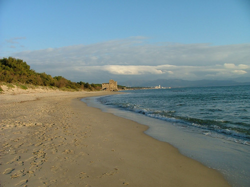 View of Torre Mozza beach with the town of Follonica in the distance