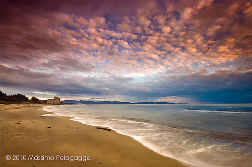 Pink beach sunset Carbonifera and Torre Mozza beaches in the Gulf of Follonica