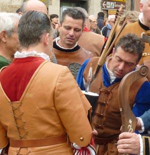 Medieval archers inspect the winnin gmedieval arrow at the 17 Trofeo di San Cerbone in Massa Marittima, Maremma Italy