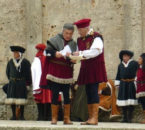 The announcers in medieval costume for the 17 Trofeo di San Cerbone in Massa Marittima, Maremma Italy