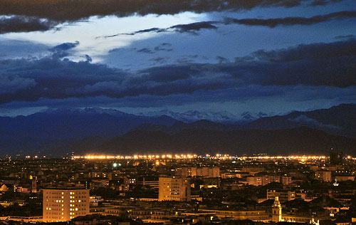 Turin photos: the city at night with a snow-covered Alpine Arch in the background