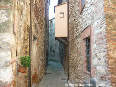 Narrow Dark Ages street inside Ravi castle, Maremma Tuscany
