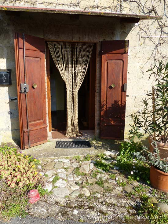Front door of cottage in Maremma for sale.