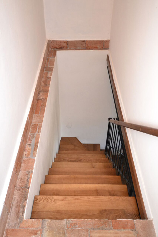 Tuscany cottage for sale: wooden stairs to upper floor.