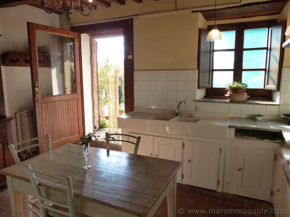 Tuscany cottage for sale: traditional Tuscan kitchen.