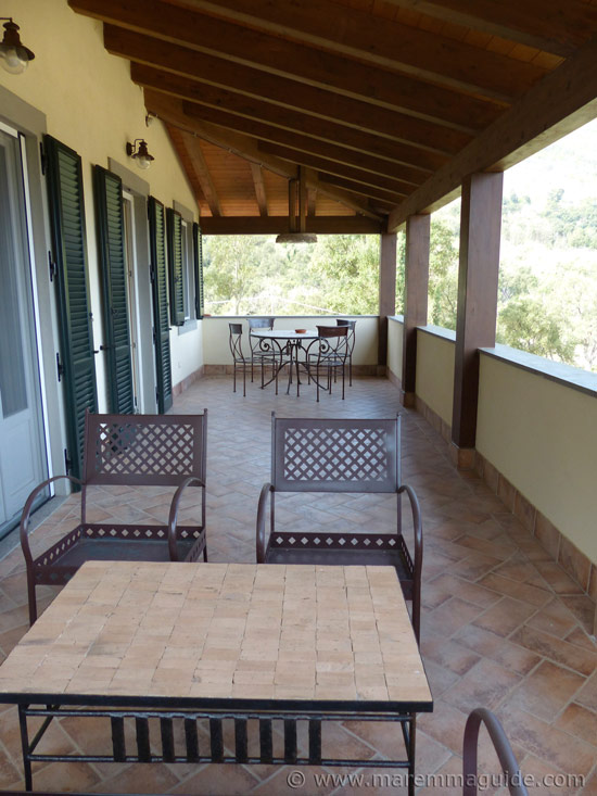 Maremma holiday accommodation: the cottage terrace with a view.