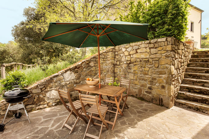 Private terrace of old stone cottage in Tuscany.