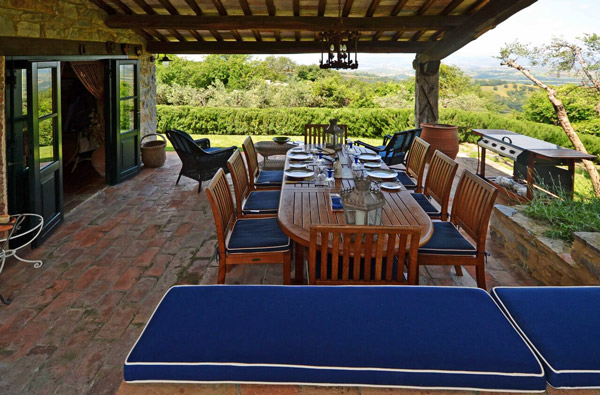Property in Tuscany: farmhouse portico with a view.