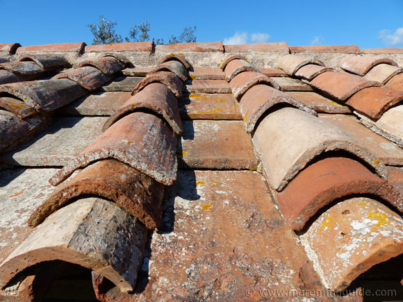 Tuscany farmhouse restoration: terracotta roof tiles.