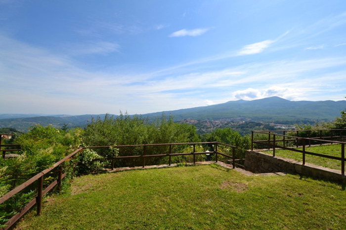 Tuscany hill town home garden with view of Monte Amiata.