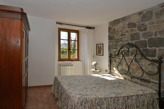 Tuscany real estate for sale: old mill bedroom.