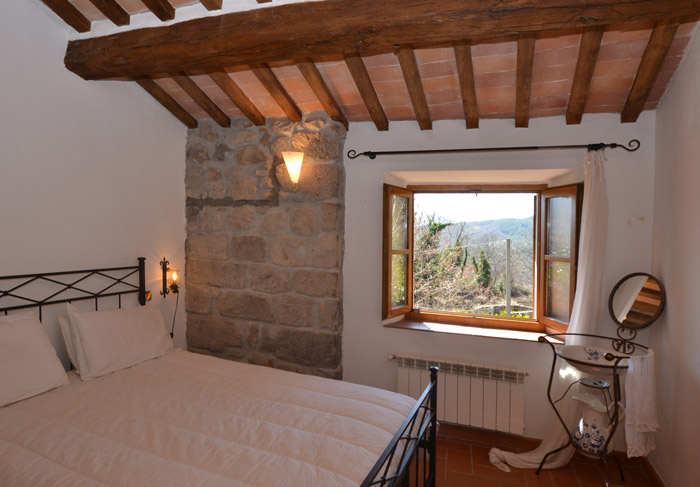 Tuscany real estate for sale: double bedroom in wter mill with a view.