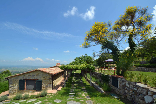 Tuscany farmhouse for sale with olive trees, pool and garden.
