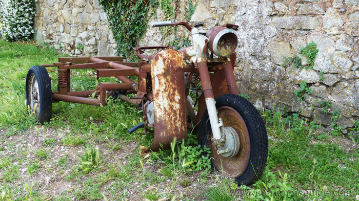 Rusting Tuscan motorbike on a grass verge in Vetulonia Tuscany