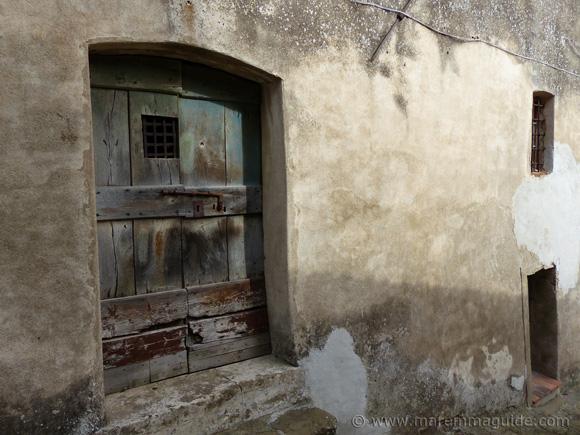 Traditional old Tuscan door in Vetulonia.