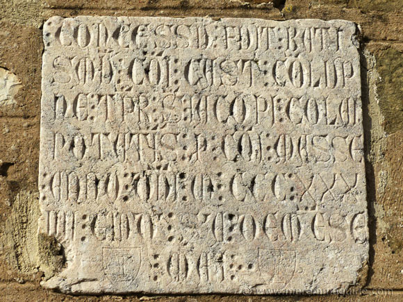 Ancient stone wall plaque in Vetulonia.