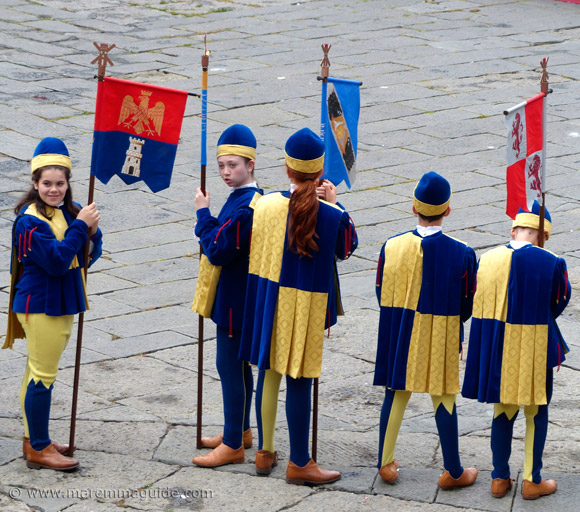 Young medieval costumed flag bearers at the Balestro del Girifalco in Massa Marittima.