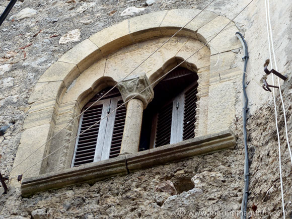 Trefoil arched mullion window in Capalbio Italy.
