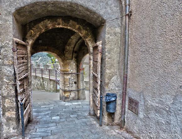 Capalbio Tuscany Italy: the Porta Senese medieval entrance to the city.