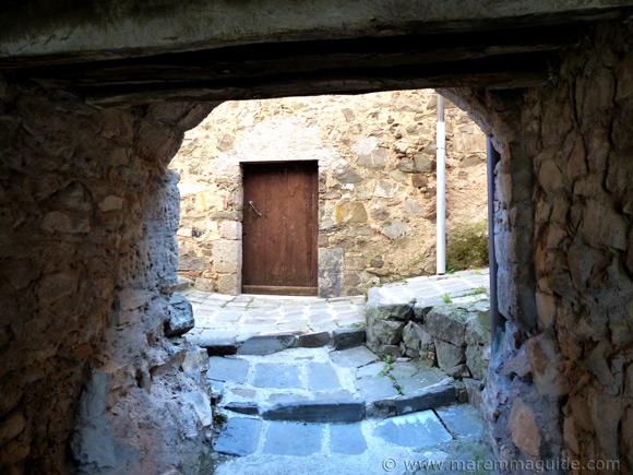 Alleyway under medieval building in Montegiovi.