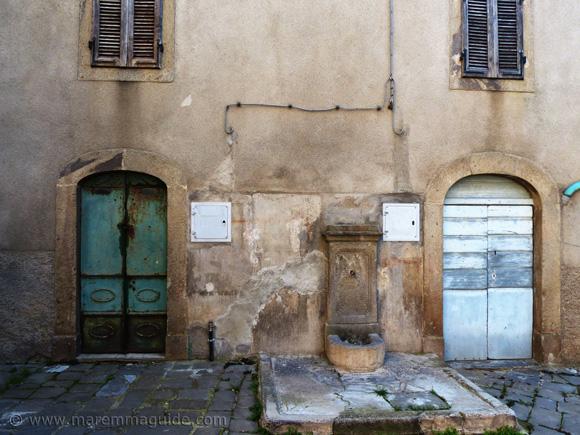 Tuscany doors and water fountain in Montegiovi.