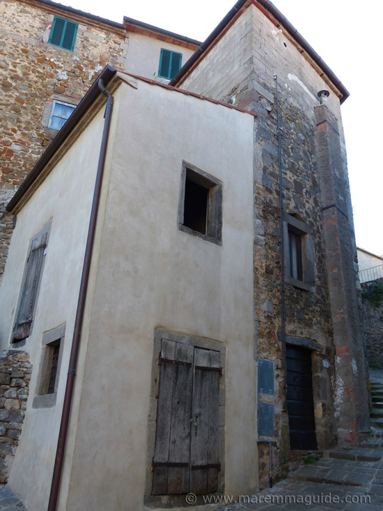 Partially restored medieval house in Montelaterone.