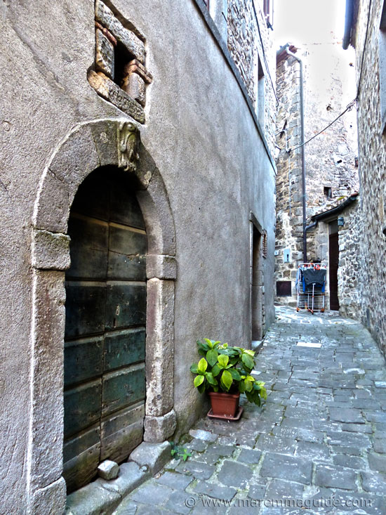 Medieval street with washing out to dry in Montelaterone Tuscany