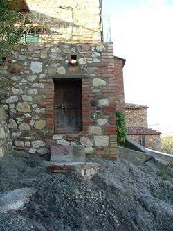 Tiny doorway in a building in Montemassi, Roccastrada, Maremma