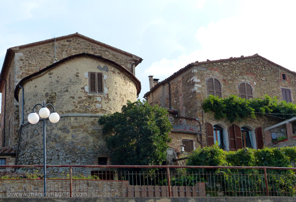 15th century tower in the city walls of Montemerano Italy