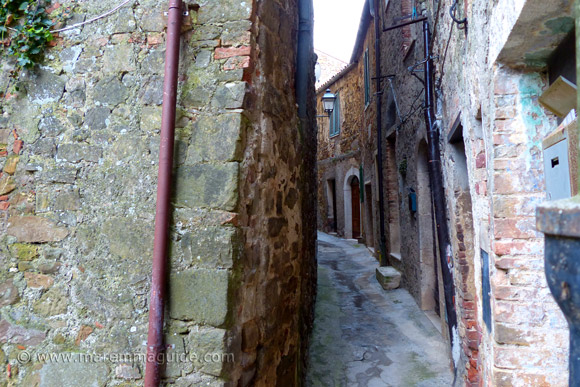 Curved medieval street inside Montemerano castle Italy