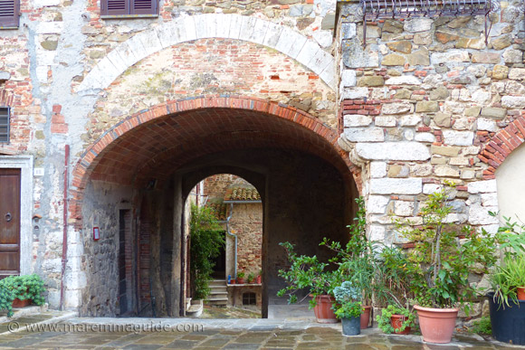 Arched entrance to Montemerano castle Maremma Italy
