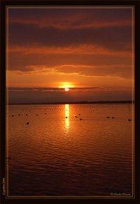 Orange sunrise over Burano lake, calpalbio, Maremma