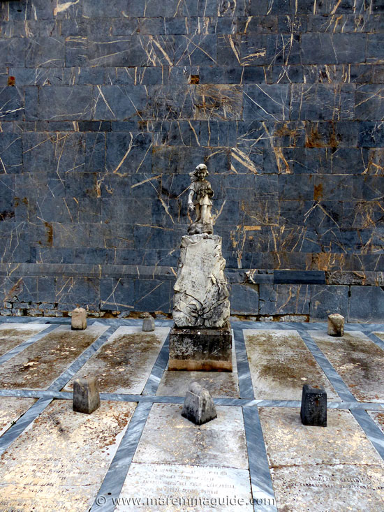 Pieve di San Giovanni: grave slabs and 1910 monument to deceased child.