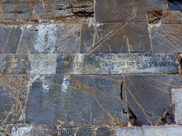 Inscription on wall of Pieve di San Giovanni, Campiglia Marittima