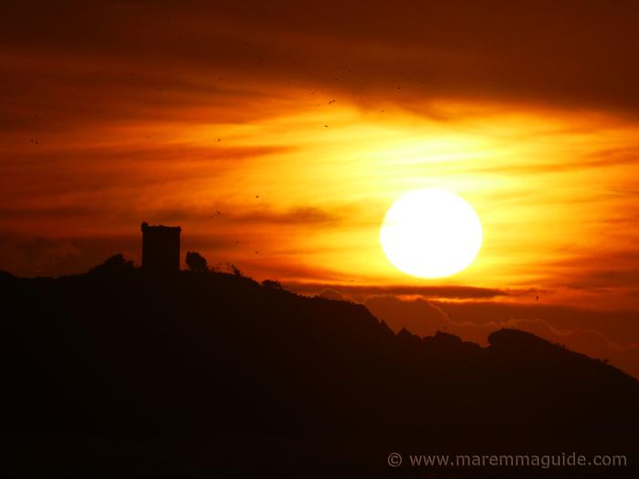 Orange sunset at Punta Ala Maremma in winter