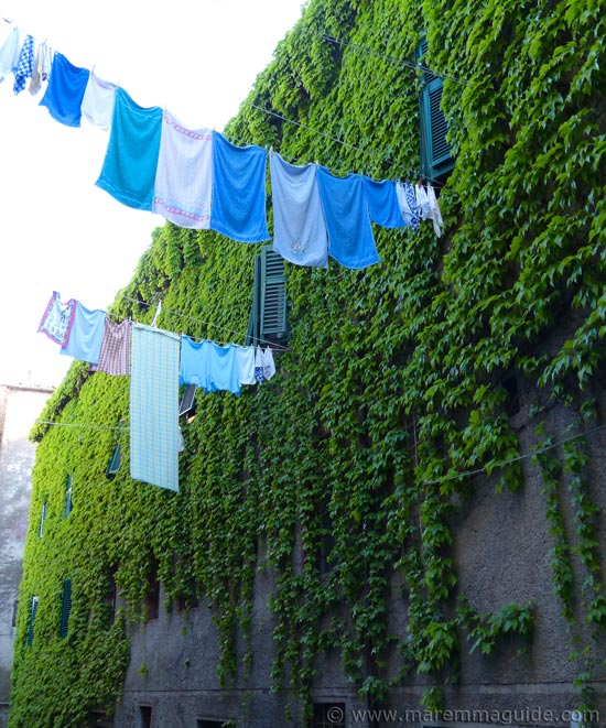 Roccastrada Tuscany washing hanging out to dry in an alley.