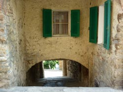 Medieval passageway: steep, arched and very low in Tatti Maremma Italy
