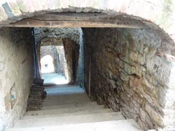 Middle ages arched alleyway in Tatti Maremma Italy