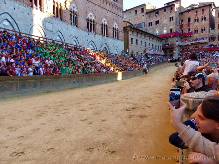 The Palio di Siena race track in front of Plazzo Pubblico heading up to the Curva del Casato.