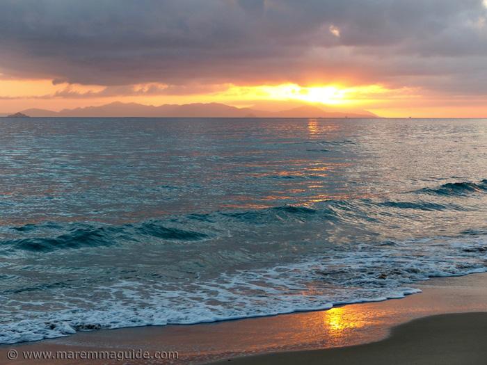 Tuscany beach sunset in December in Maremma.