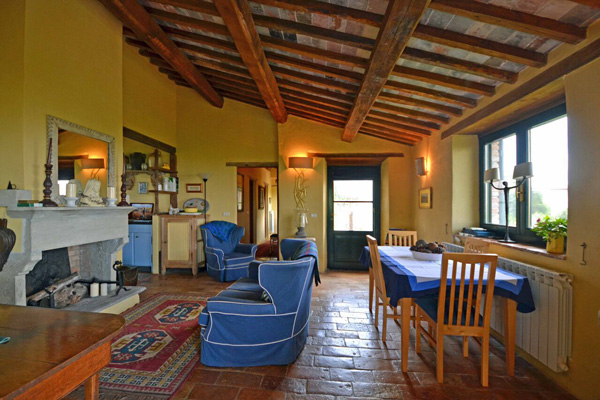 Living/dining room of the Tuscany farmhouse in Maremma for sale.